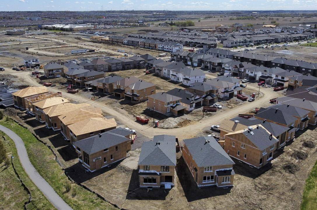 """New homes are built in a housing construction development in the west end of Ottawa on Thursday, May 6, 2021. NDP Leader Jagmeet Singh is pledging a hefty foreign home buyers' tax and """"massive"""" investment in housing to chill a white-hot real estate market.THE CANADIAN PRESS/Sean Kilpatrick"""