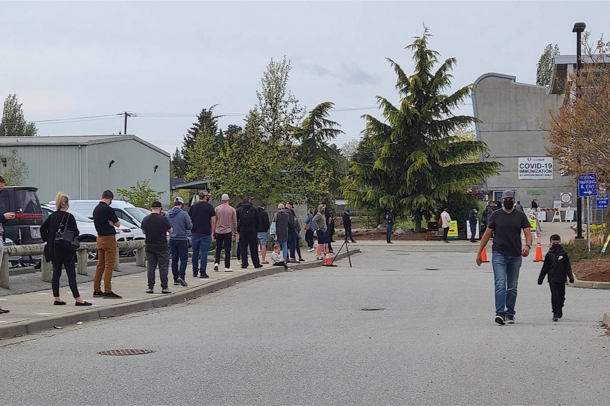 People line up for COVID-19 vaccination at a drop-in clinic at Cloverdale Recreation Centre on Wednesday, April 27, 2021. Public health officials have focused efforts on the Fraser Health region. (Aaron Hinks/Peace Arch News)