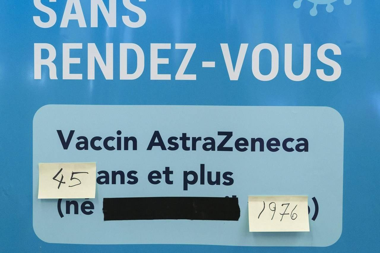 A sign is seen at a walk-in COVID-19 in Montreal on Wednesday, April 21, 2021. THE CANADIAN PRESS/Paul Chiasson