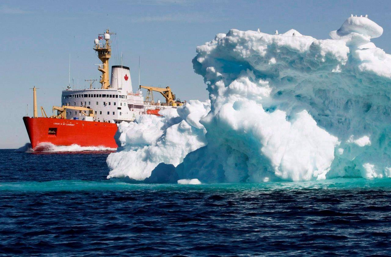 The Canadian Coast Guard icebreaker Louis S. St-Laurent sails past a iceberg in Lancaster Sound, Friday, July 11, 2008. The federal government is expected to end nearly two years of mystery today and reveal its plan to build a new, long overdue heavy icebreaker for the Canadian Coast Guard. THE CANADIAN PRESS/Jonathan Hayward