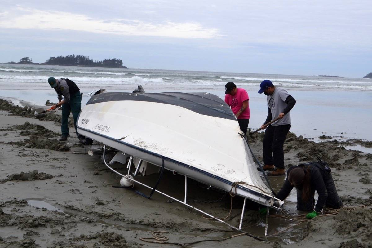 Parks Canada and Tla-o-qui-aht Tribal Parks dig the washed up Princess M out from sand along the south shore of the Pacific Rim National Park Reserve. (Nora O'Malley photo)