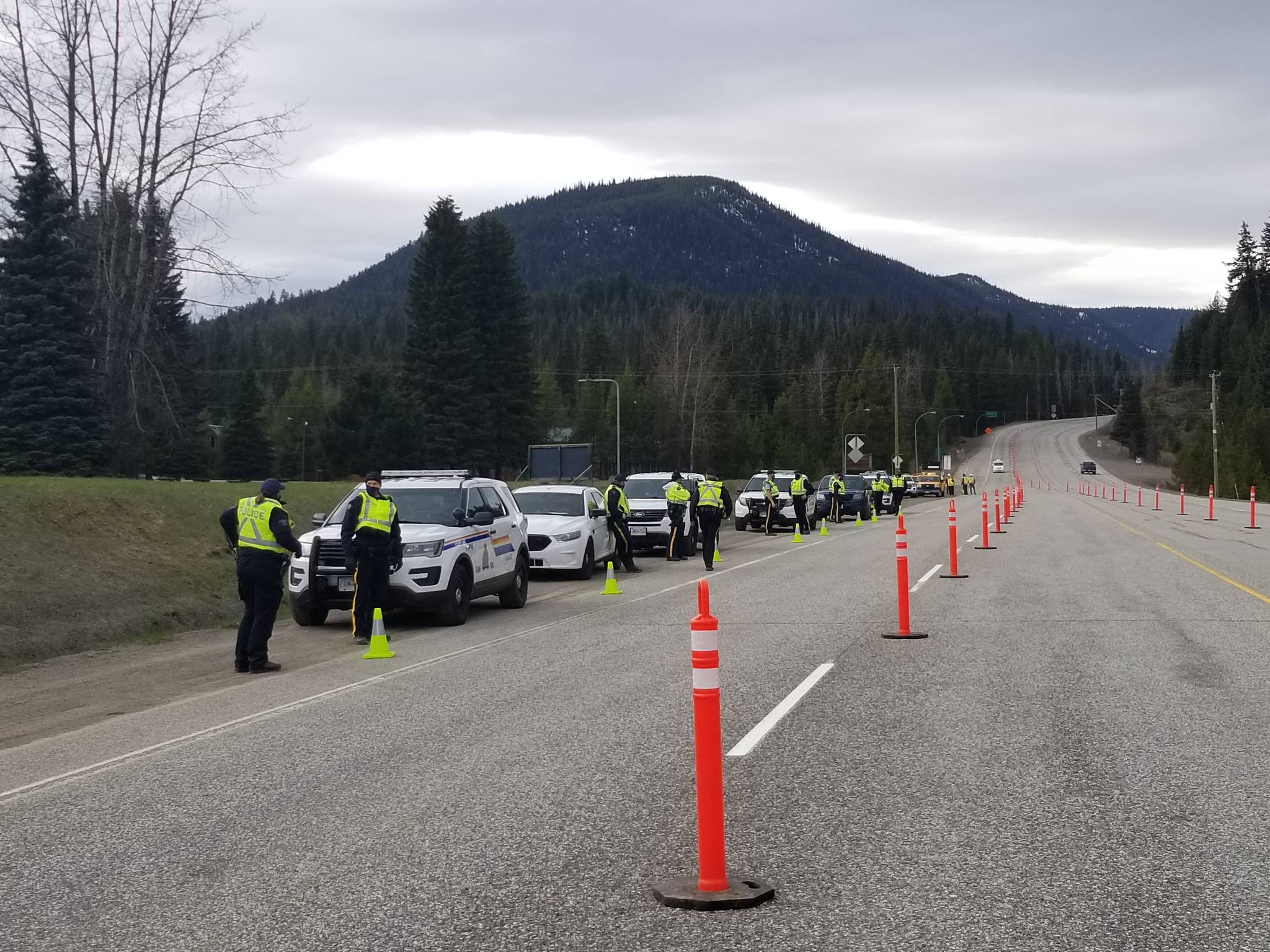 Police officers at this Highway 3 check point will be asking for identification from drivers, documentation regarding the driver's name and address, and the purpose for the driver's travel. Photo RCMP