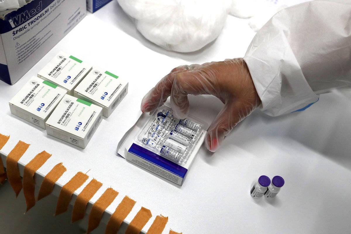 A medical worker prepares vials of the COVID-19 vaccine Chinese Sinopharm. (AP Photo/Darko Vojinovic)