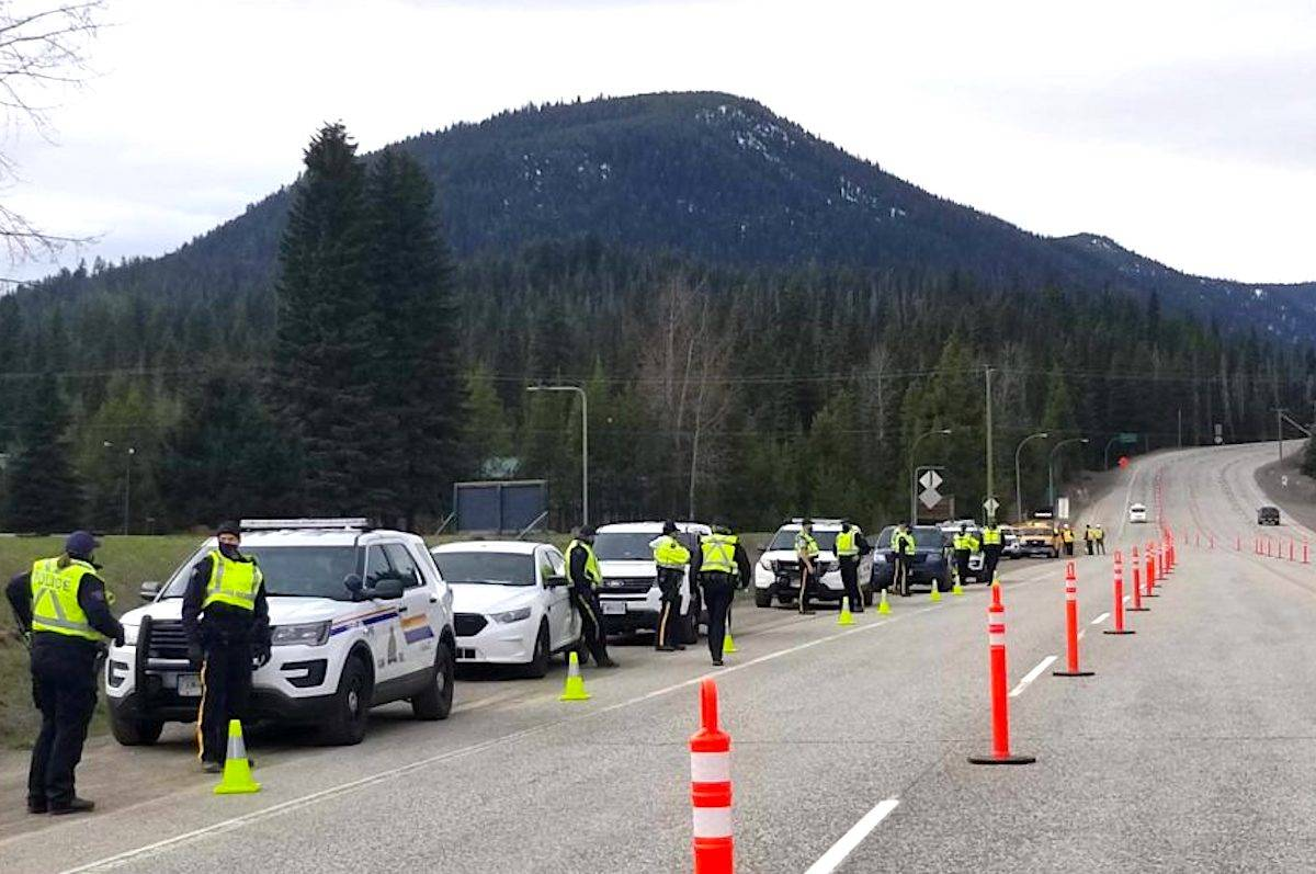 At this Highway 3 check point, police officers will be asking for identification from drivers, documentation regarding the driver's name and address, and the purpose for the driver's travel. (RCMP)