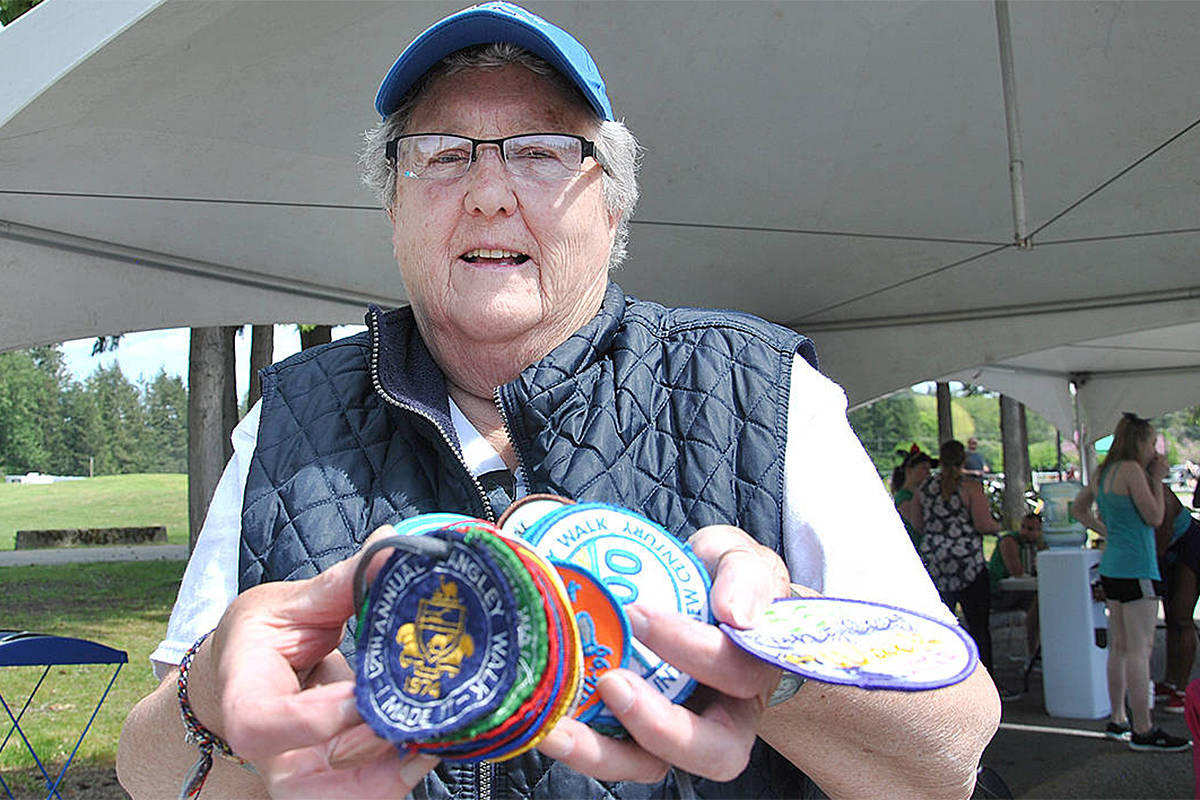 Monica Newman has been part of the Langley Walk for more than 40 years, both as a participant and more recently as a volunteer, collecting badges for each year. (Langley Advance Times files)