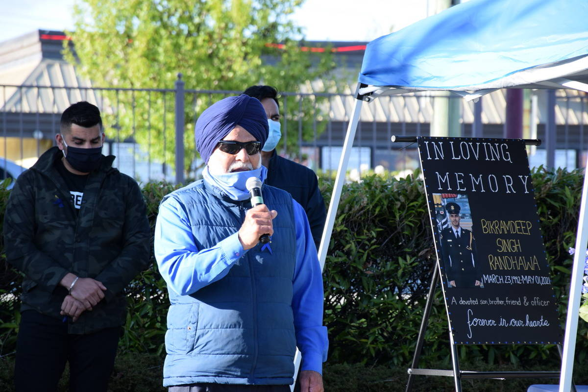 Joginder Singh Randwaha, uncle of slain corrections officer Bikramdeep Randhawa, address the crowd gathered at a candlelight vigil Friday evening (May 7) to remember the victim in last weekend's brazen daylight shooting outside North Delta's Scottsdale Centre mall. (James Smith photo)