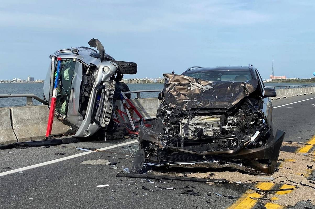 =A bystander jumped over a highway guard rail and into a Maryland bay Sunday to rescue a child who had been thrown from a car and into the water during the crash. (Ocean City Fire Department)