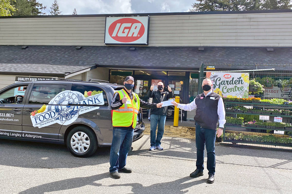 On hand for the presentation of a cheque to the Langley Food Bank was Jim Calamunce, executive director of the food bank (L), Langley City councillor Rudy Storteboom (centre) and Mike Partridge, manager of the South Langley IGA. (R) (Special to Langley Advance Times)