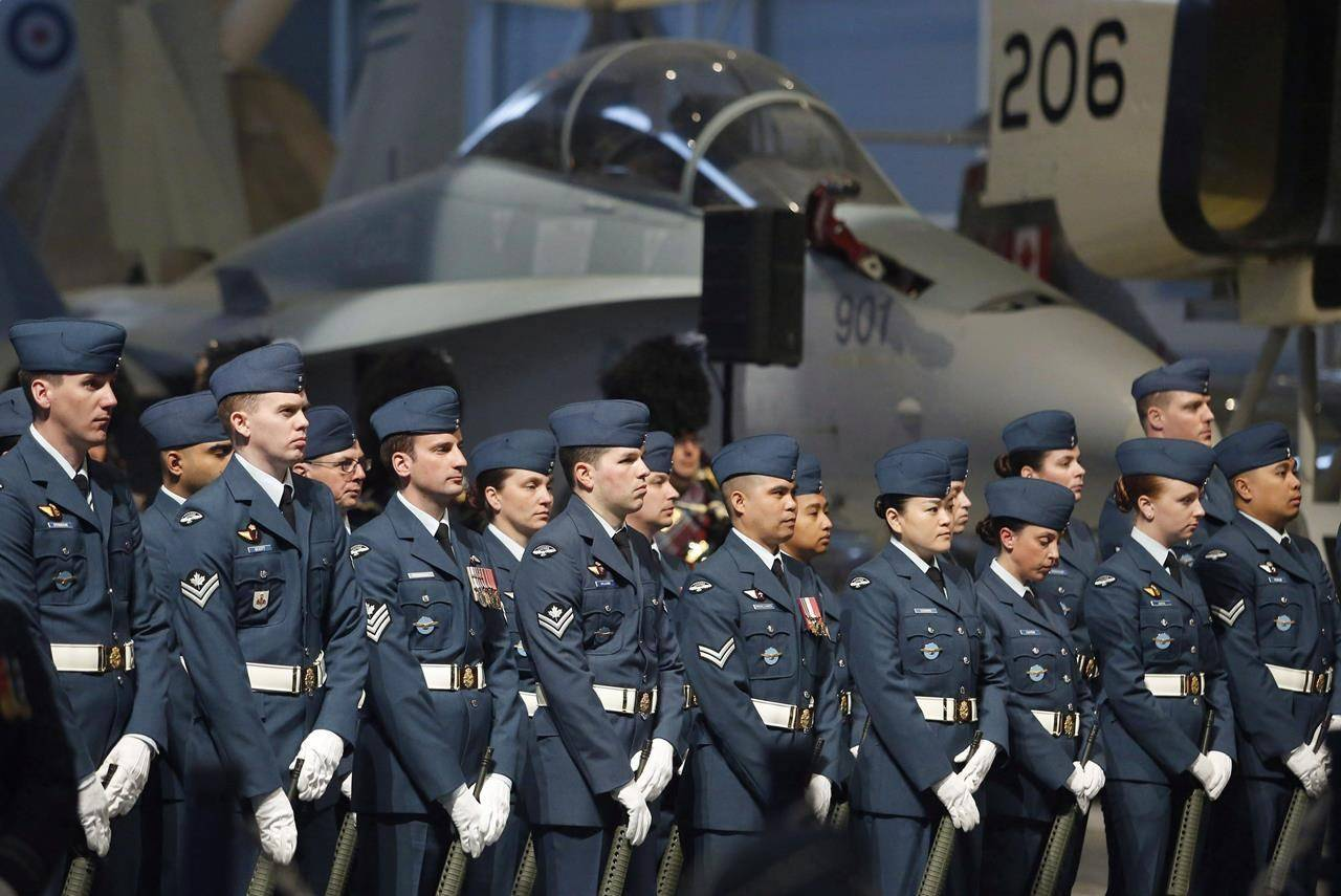 Members of the RCAF take part in a Royal Canadian Air Force change of command ceremony in Ottawa on Friday, May 4, 2018. The Royal Canadian Air Force is hoping Canada will open its doors to military pilots from other countries as it seeks to address a longstanding shortage of experienced aviators. THE CANADIAN PRESS/ Patrick Doyle