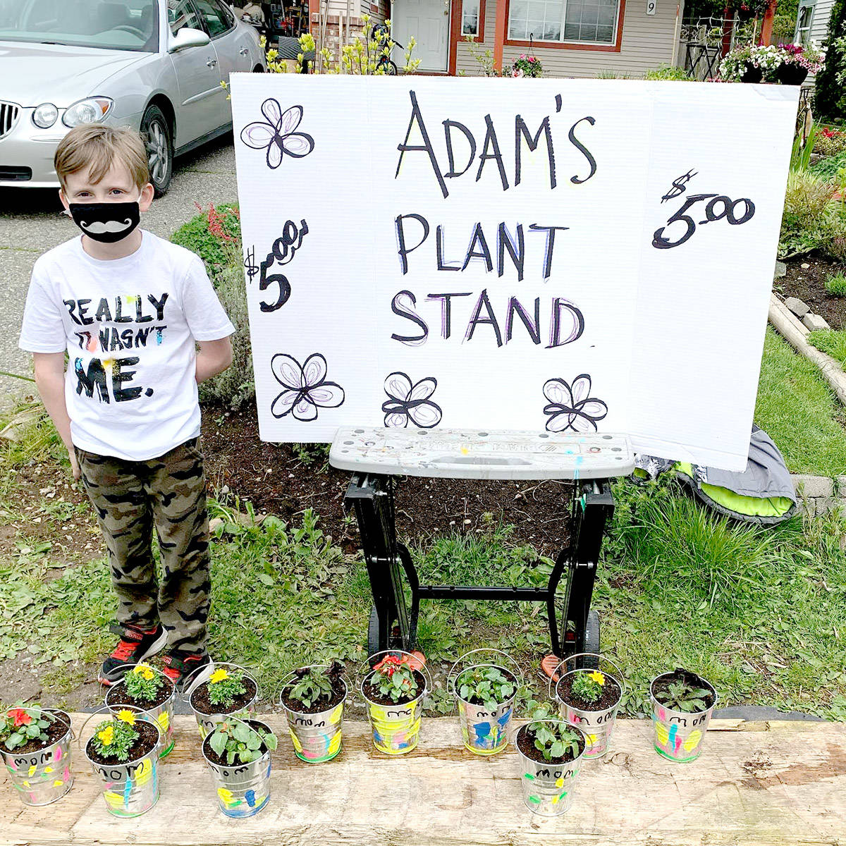 Seven-year-old Adam Dadson opened his own plant stand at 24th Ave and 268 Street in Aldergrove. (Val Dadson/Special to The Star)