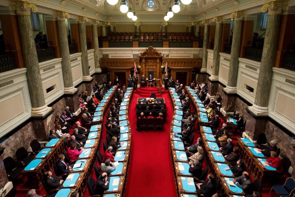 The B.C. legislature went from 85 seats to 87 before the 2017 election, causing a reorganization with curved rows and new desks squeezed in at the back. The next electoral boundary review could see another six seats added. (Black Press files)