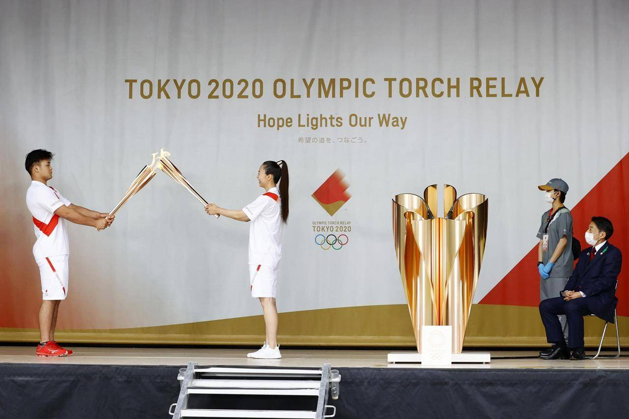 The Tokyo Olympic torch relay was taken off public roads due to the coronavirus pandemic. (Kyodo News via AP)