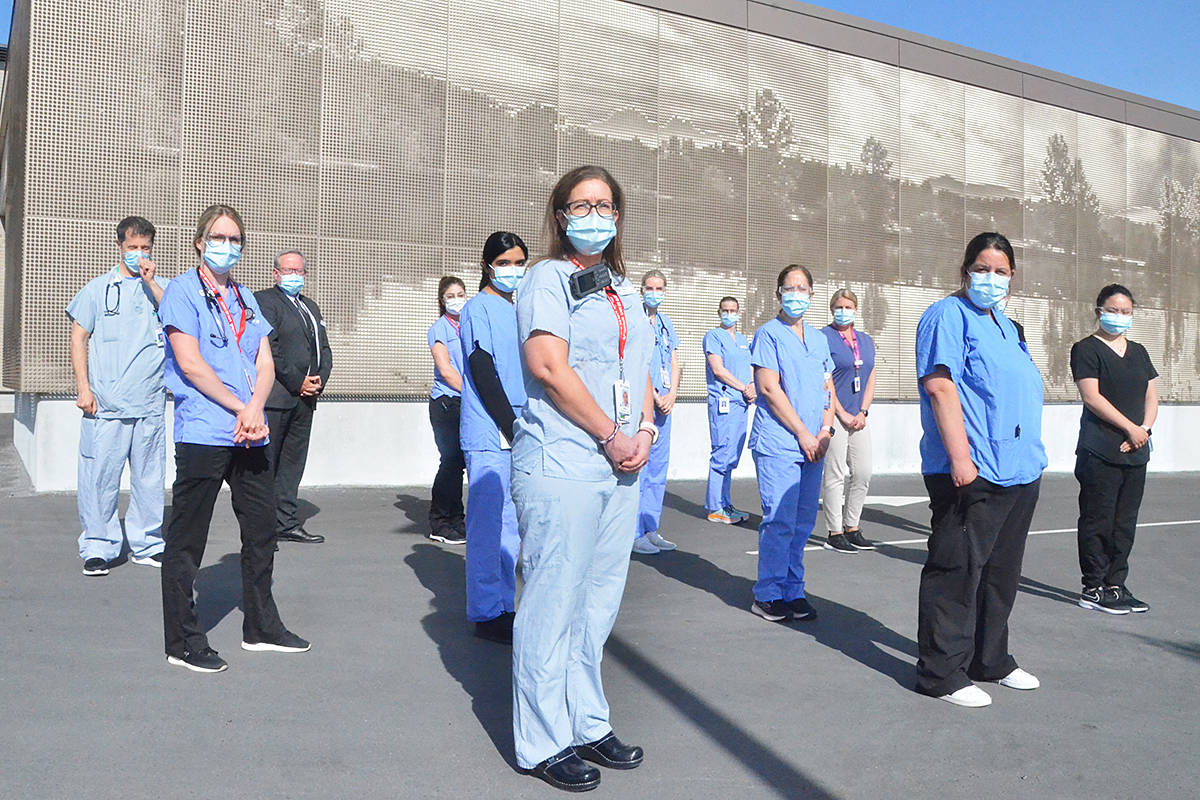 The ER nurses, doctors, and medical technicians at Langley Memorial Hospital in front of the mural on the new admitting bay. The ER opened at the beginning of May after years of fundraising and construction. (Matthew Claxton/Langley Advance Times)
