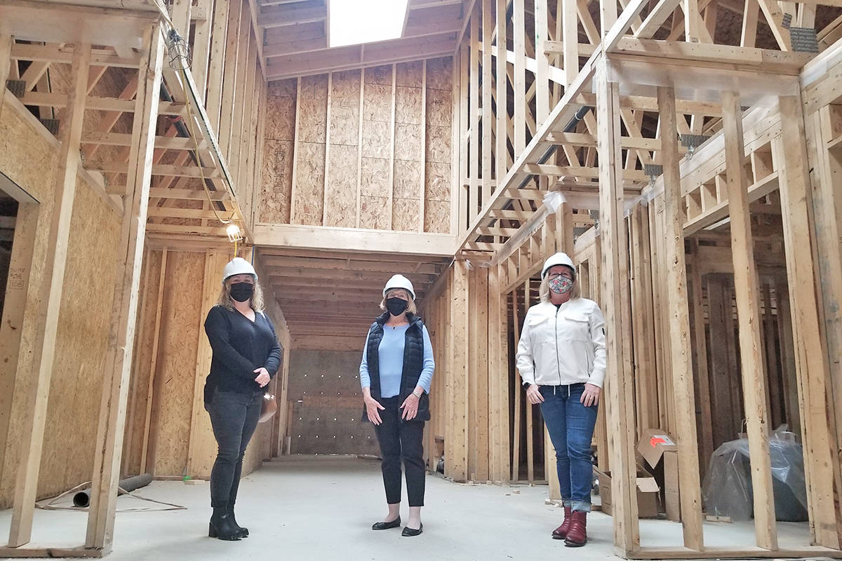 Carissa Halley, Kathy Derksen and Shannon Todd Booth of the Langley Hospice Society visited the under-construction new facility in late April. (Dan Ferguson/Langley Advance Times)