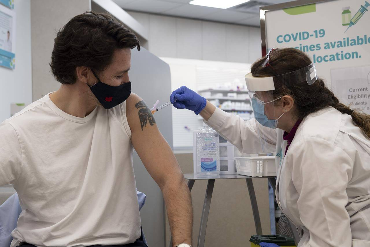 Prime Minister Justin Trudeau receives his COVID-19 AstraZeneca vaccination in Ottawa, Friday, April 23, 2021. THE CANADIAN PRESS/Adrian Wyld