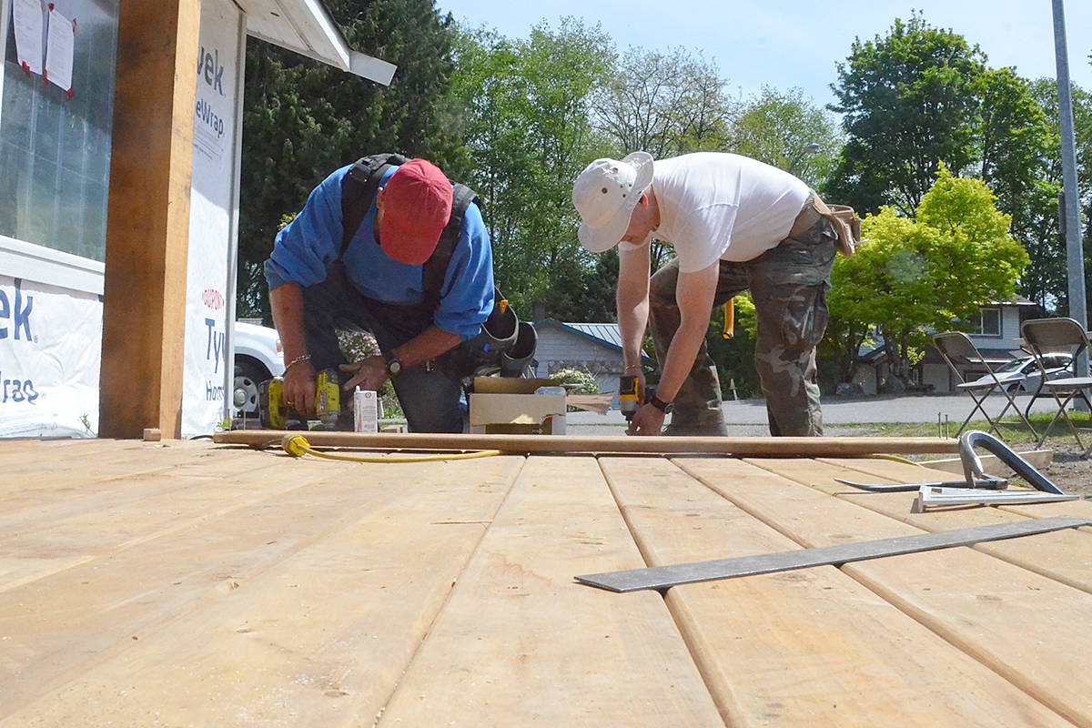 Brian Smith, left, and Terry Hughes build a wheelchair ramp as part of the AOK Extreme Home Repair project in Langley City on May 11, 2021. (Matthew Claxton/Langley Advance Times)