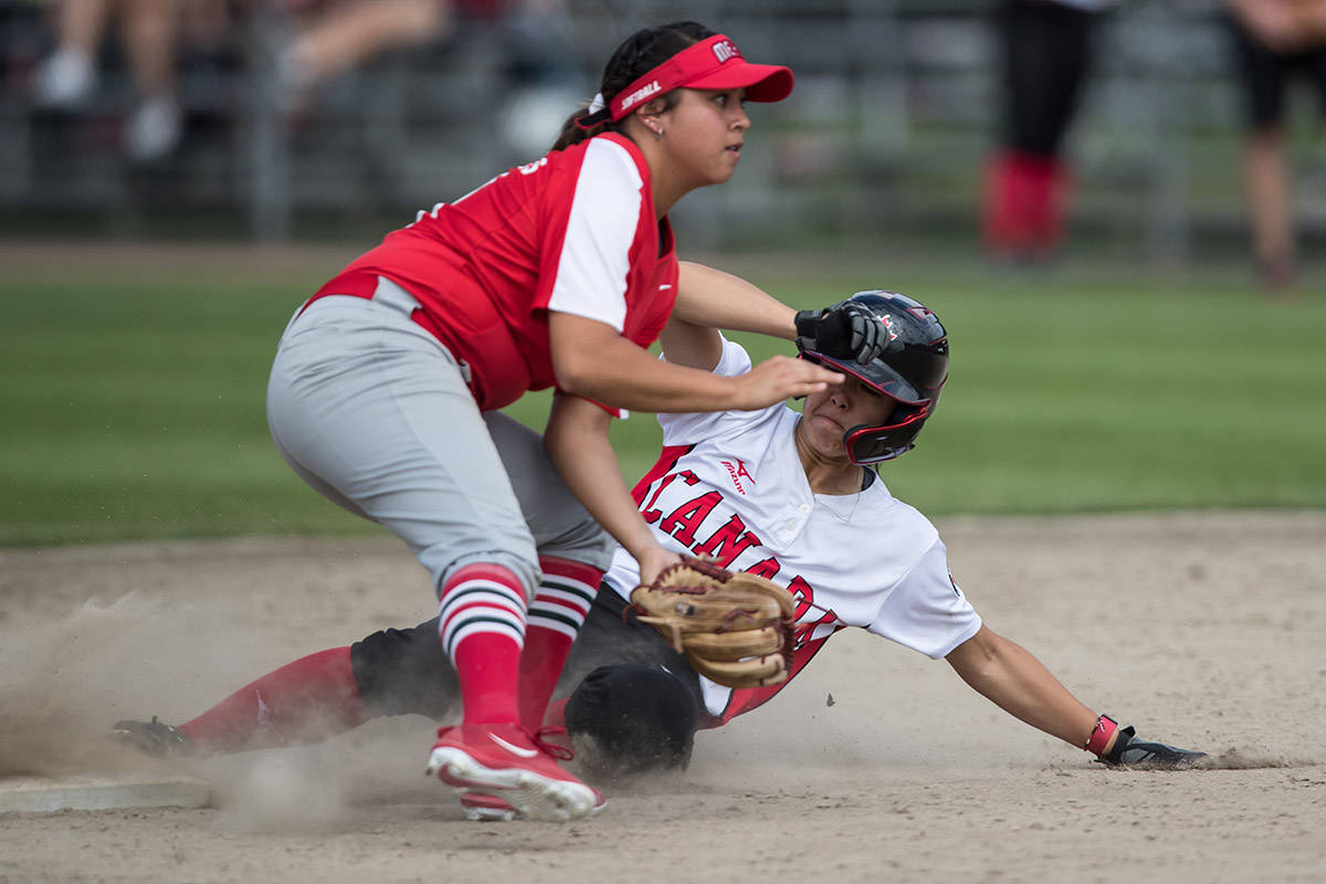 Canada's Janet Leung steals second base during playoff action at the Softball Americas Olympic Qualifier tournament in South Surrey on August 31, 2019. Leung and her teammates have not been back to Softball City since, as the 2020 and now '21 Canada Cup tournaments have been cancelled. (THE CANADIAN PRESS/Darryl Dyck photo)
