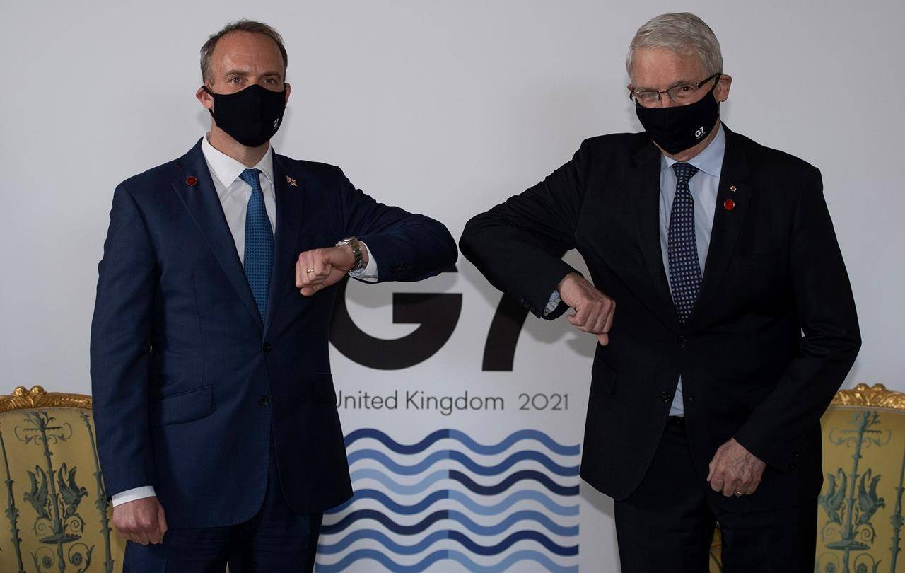 Britain's Foreign Secretary Dominic Raab, left, poses for a photo with his Canadian counterpart Marc Garneau Tuesday, May 4, 2021.THE CANADIAN PRESS/AP-Eddie Mulholland