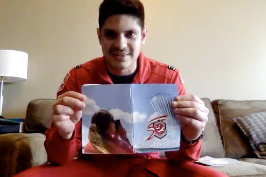 Capt. Arpit Mahajan of the Canadian Forces Snowbirds - Snowbirds 2 - shows off his 'Jenn Book' dedicated to Capt. Jennifer Casey. Zoom screenshot