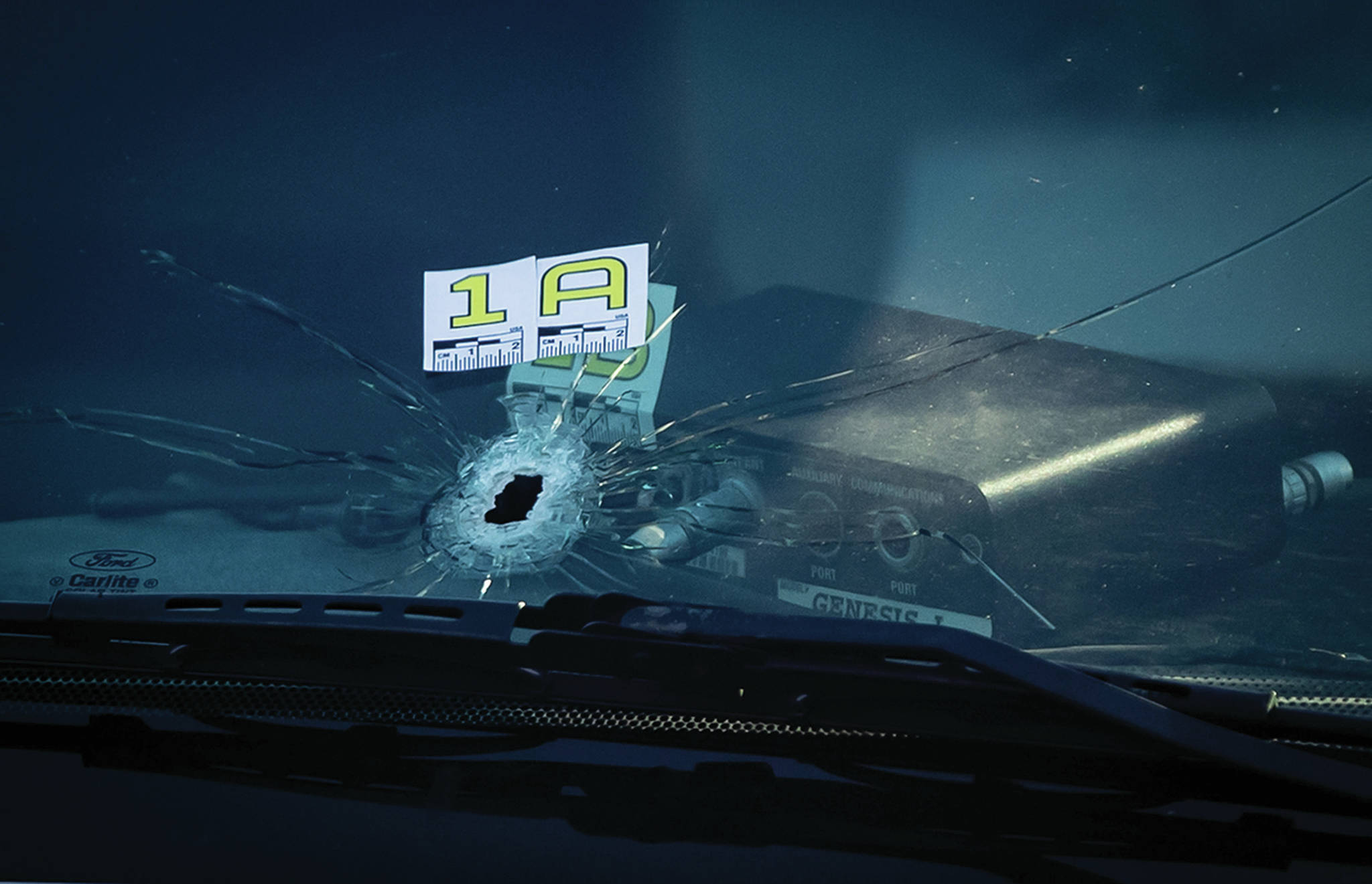 A bullet hole is seen in the windshield of an RCMP vehicle approximately 4 km from Vancouver International Airport after a one person was killed during a shooting outside the international departures terminal at the airport, in Richmond, B.C., Sunday, May 9, 2021. THE CANADIAN PRESS/Darryl Dyck