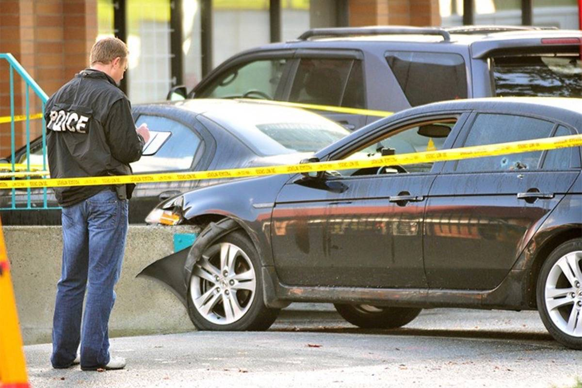 Police investigate a fatal 2011 shooting in a strip mall across from Central City Shopping Centre, which was deemed a gang hit. The Mayor's Gang Task Force zeroed in on ways to reduce gang involvement and activity. (File photo)