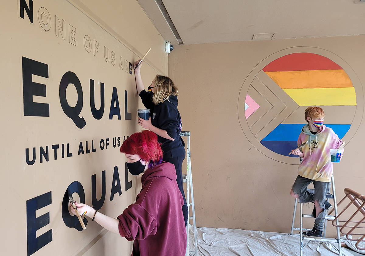 Rainbow Club students at MRSS paint messaging outside the school's main entrance. (Neil Corbett/The News)