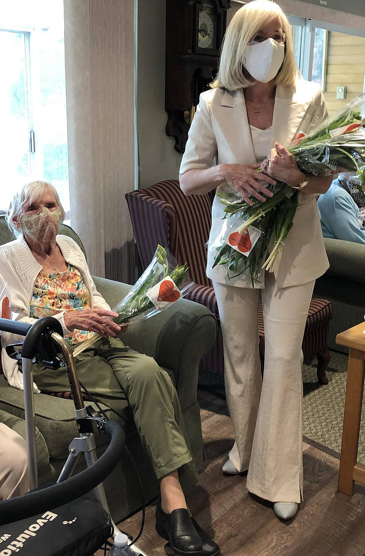 Cloverdale-Langley City MP Tamara Jansen (right) delivered bouquets of tulips to residents at Manoah Manor in Langley on the 76th anniversary of the liberation of the Netherlands. (Special to Langley Advance Times)