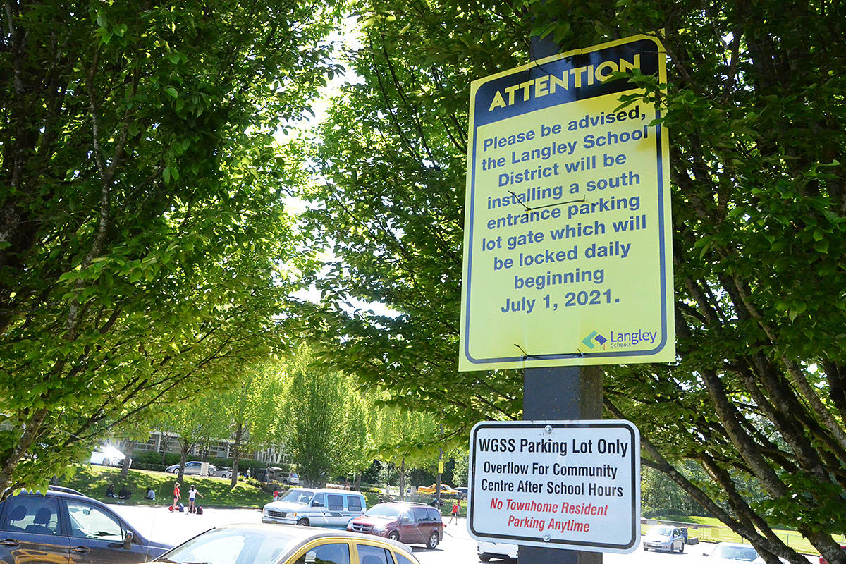 Temporary signs warn people that the overflow parking lot at Walnut Grove Secondary will soon be locked at night – something causing distress for some nearby townhouse residents. (Matthew Claxton/Langley Advance Times)