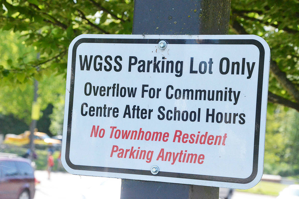 Existing signs warn residents of townhouses not to park in the WGSS overflow lot, but locals say that rule has not been enforced. (Matthew Claxton/Langley Advance Times)