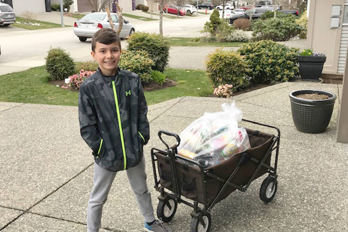 Nixon Mahovlic, 8, was inspired by kindness week at Fort Langley Elementary so he set out to collect bottles to raise money for a local family in need. (Steve Mahovlic/Special to Langley Advance Times)