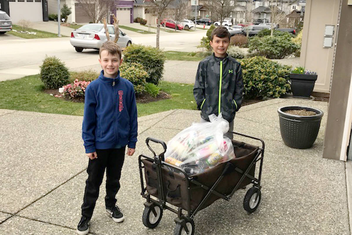 Nixon Mahovlic, 8, (right) was inspired by kindness week at Fort Langley Elementary so he set out to collect bottles to raise money for a local family in need. Nixon even recruited his neighbour Kayden to help. (Steve Mahovlic/Special to Langley Advance Times)