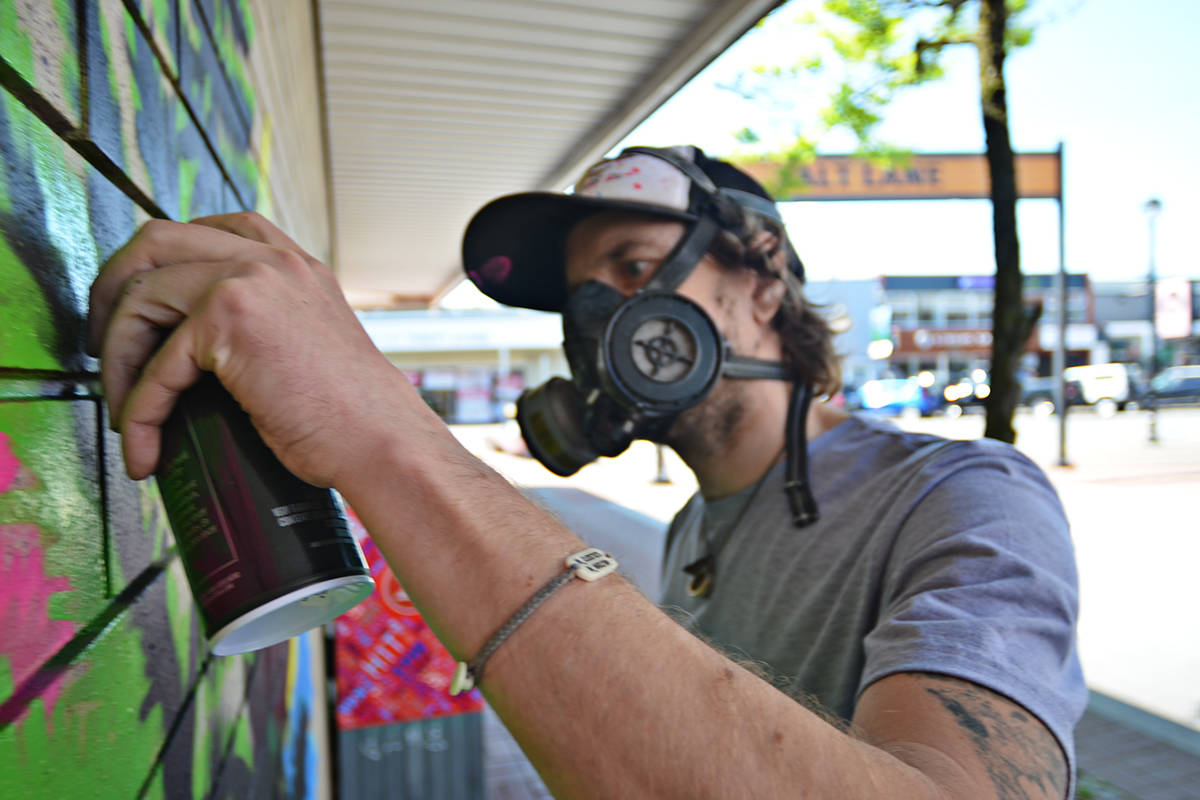 Alex Stewart painted Langley City's newest mural on Friday, May 14, 2021. (Heather Colpitts/Langley Advance Times)