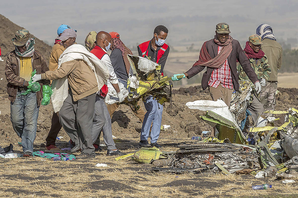 Rescuers work at the scene of an Ethiopian Airlines flight crash near Bishoftu, or Debre Zeit, south of Addis Ababa, Ethiopia on March 10, 2019 (AP/Mulugeta Ayene)