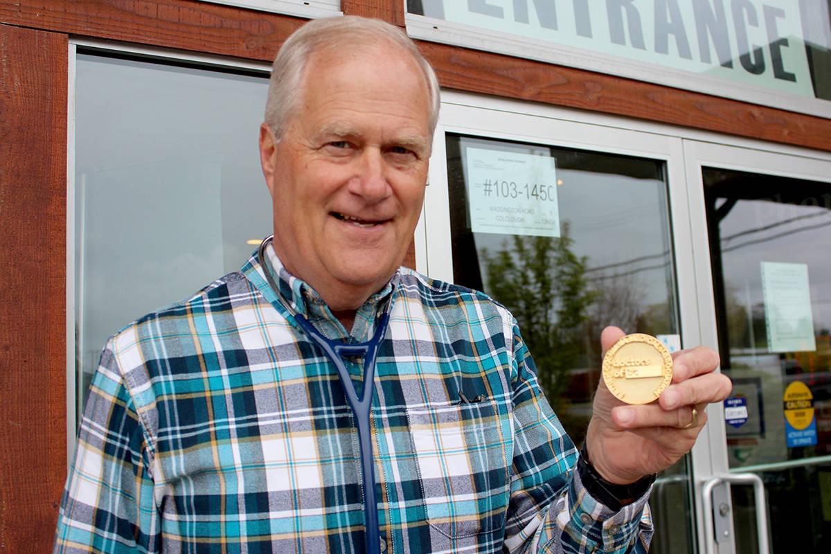 Dr. Steve Beerman, of Nanaimo, shows off his Dr. David Bishop Gold Medal, awarded for distinguished medical service. (Karl Yu/News Bulletin)