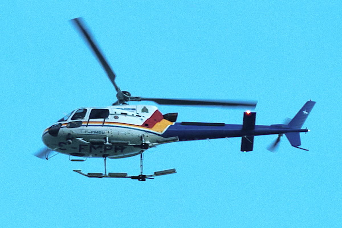 Crowds at English Bay were blasted with a large beam of light from an RCMP Air-1 helicopter on Friday, May 14. THE CANADIAN PRESS/Marc Grandmaison