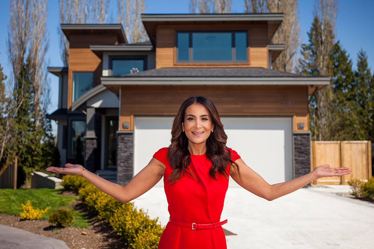 Lottery spokesperson Karen Khunkhun shows off the 4,724 sq. ft. South Surrey home, part of a $2.6 million Grand Prize package.