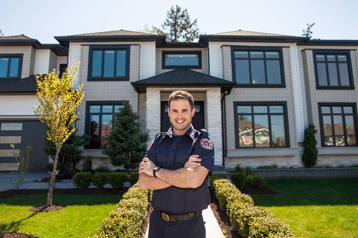 Hometown Heroes Lottery spokesperson Sebastian Sevallo outside of the 5,137 sq. ft. Grand Prize home in Langley, in Murrayville.