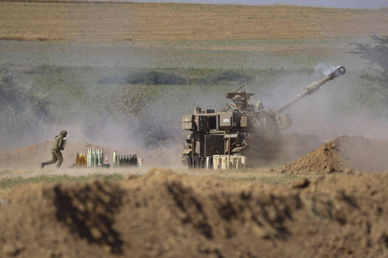 An Israeli artillery unit fires toward targets in the Gaza Strip, at the Israel-Gaza border, Saturday, May 15, 2021. (AP Photo/Ariel Schalit)