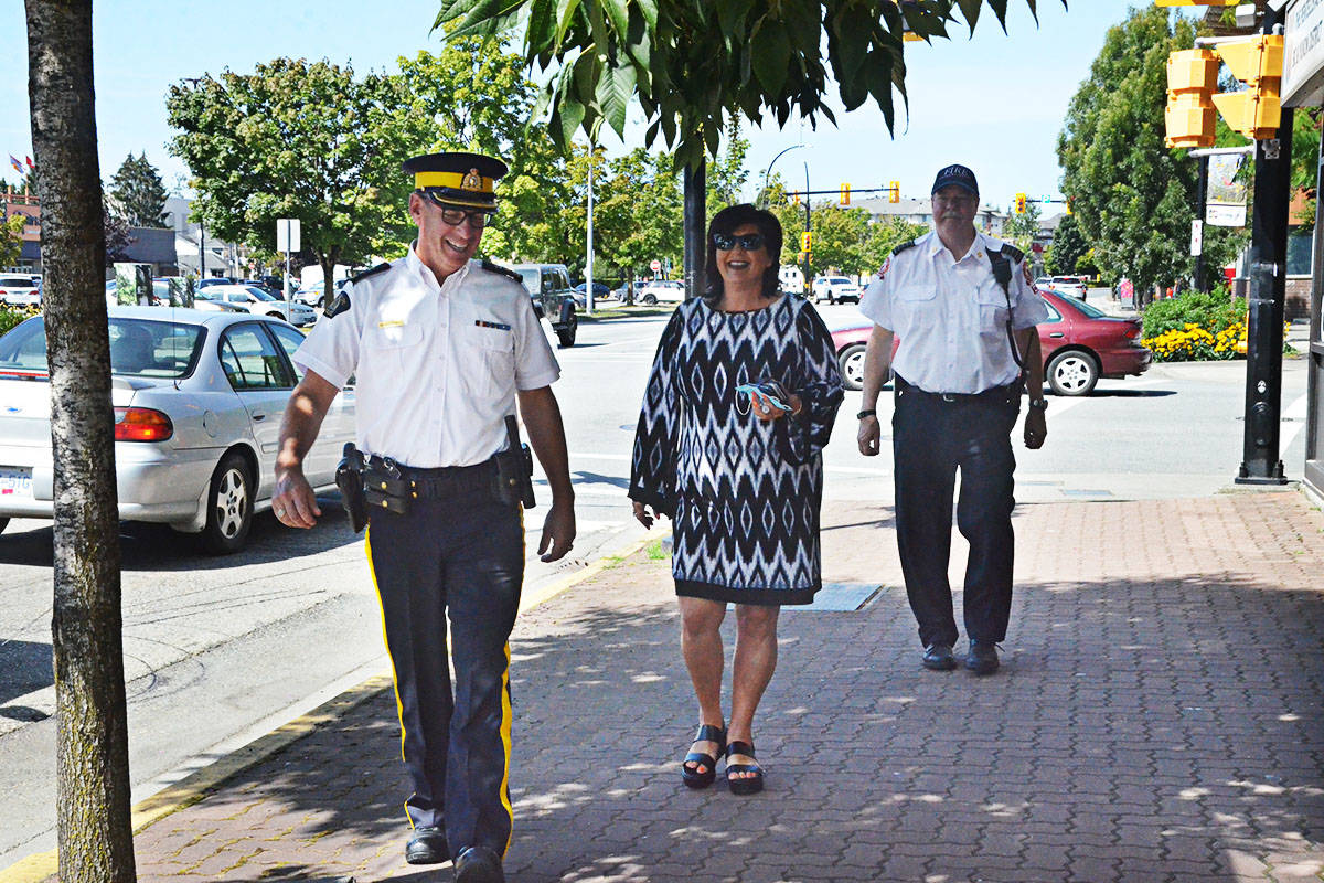 Langley RCMP Supt. Murray Power, City Mayor Val van den Broek, and City fire chief Rory Thompson visited local businesses and talked to residents on the street in summer 2020. (Langley Advance Times files)