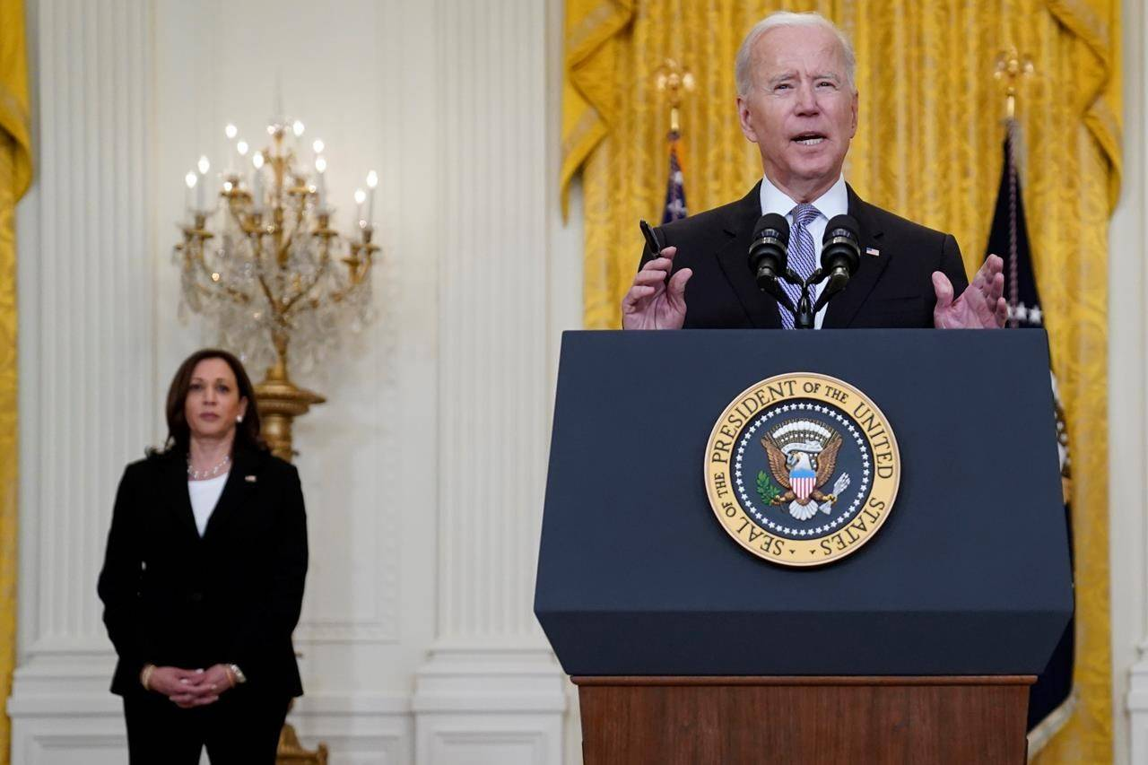 Vice President Kamala Harris listens as President Joe Biden speaks about distribution of COVID-19 vaccines, in the East Room of the White House, Monday, May 17, 2021, in Washington. (AP Photo/Evan Vucci)