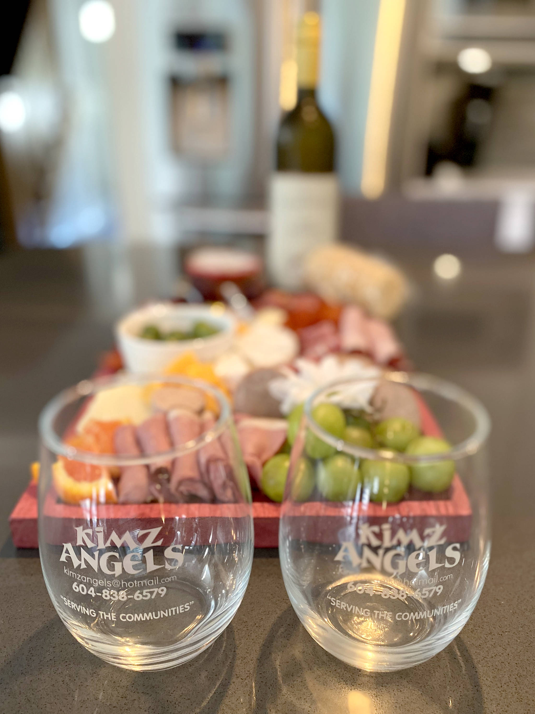 """On April 17, 2021, people who purchased tickets to the """"Angels Working Together"""" virtual gala came together online with a bottle of wine and a Kimz Angels engraved charcuterie board with meats and cheeses, all delivered to their door on the day of the event. (Langley Advance Times)"""