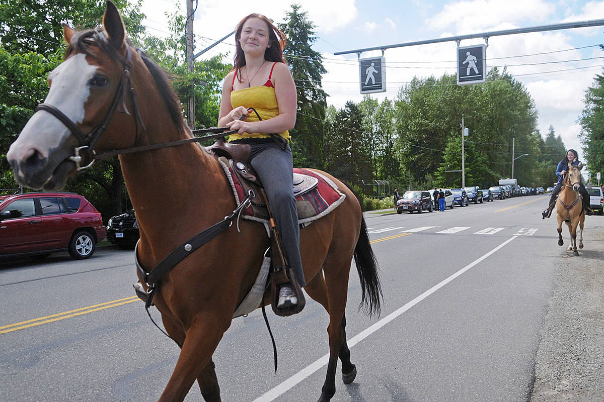 Horses and riders, such as these on 36th Avenue near Noel Booth Park, are common sights on roads around Langley. (Langley Advance Times files)