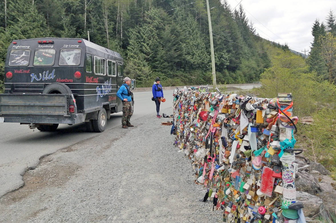 A crew of WestCoast WILD Adventures employees tackled an onslaught of litter left at the 'Locks of Love' fence at Wally Creek on May 2. (Anne-Marie Gosselin photo)