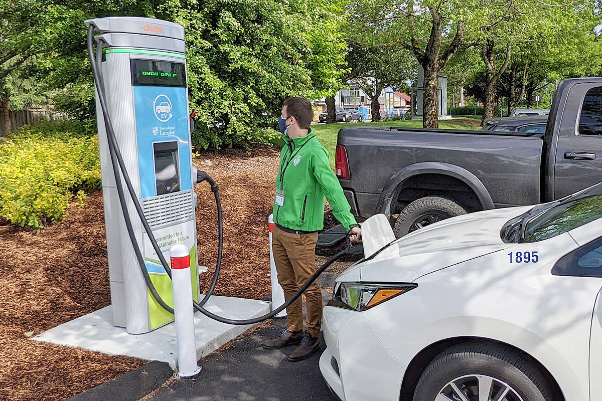Township of Langley Energy Manager Greg Dennis tests the DC Fast Charger's inaugural charge, May 18. The DC Fast Charger can add over 100 kilometres of electric range per hour and is the fourth of its kind in the Township. (Langley Township/Special to the Langley Advance Times)