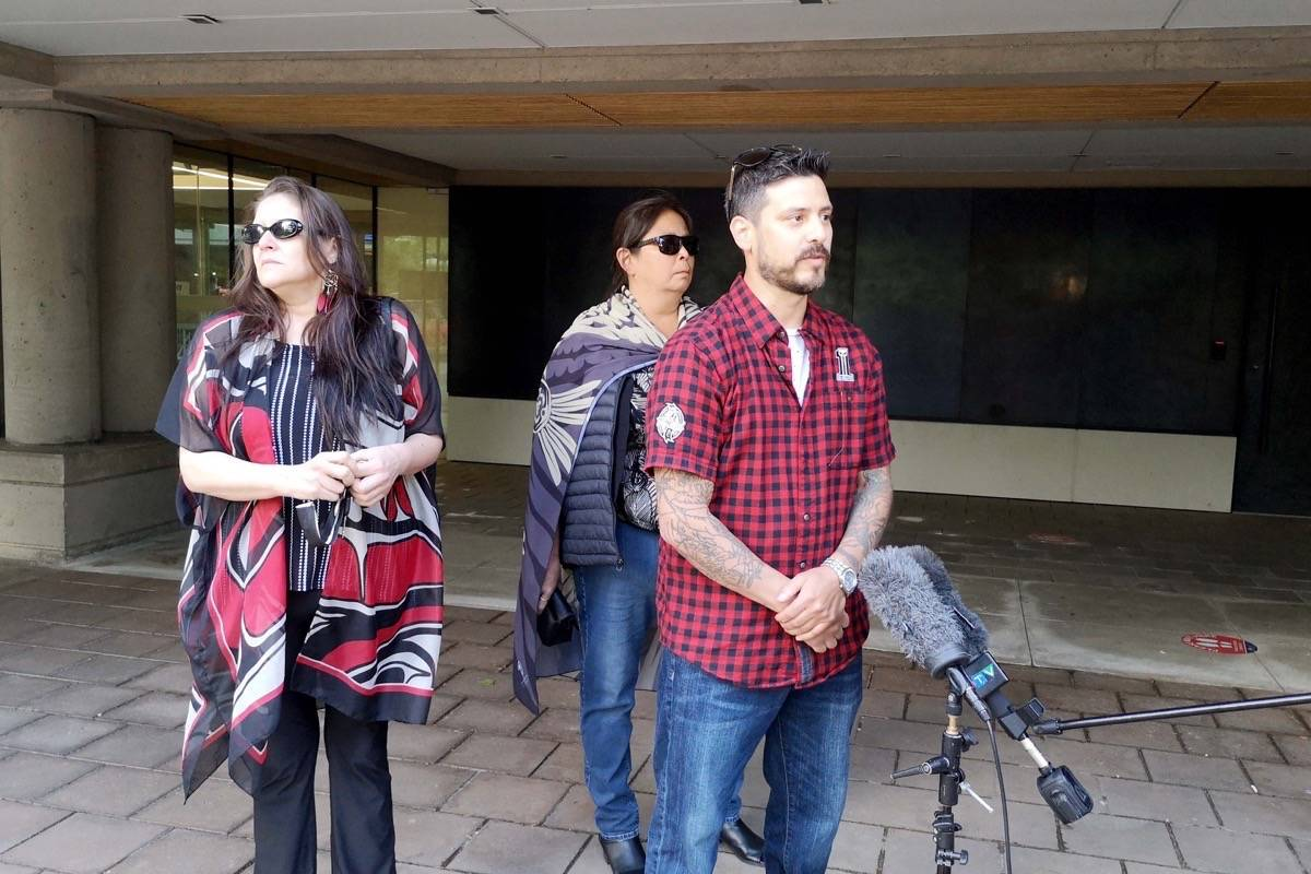 Stephen Prestbakmo, backed by his sisters Angela (left) and Liz, speaks to reporters following the verdict. (Tracy Holmes photo)