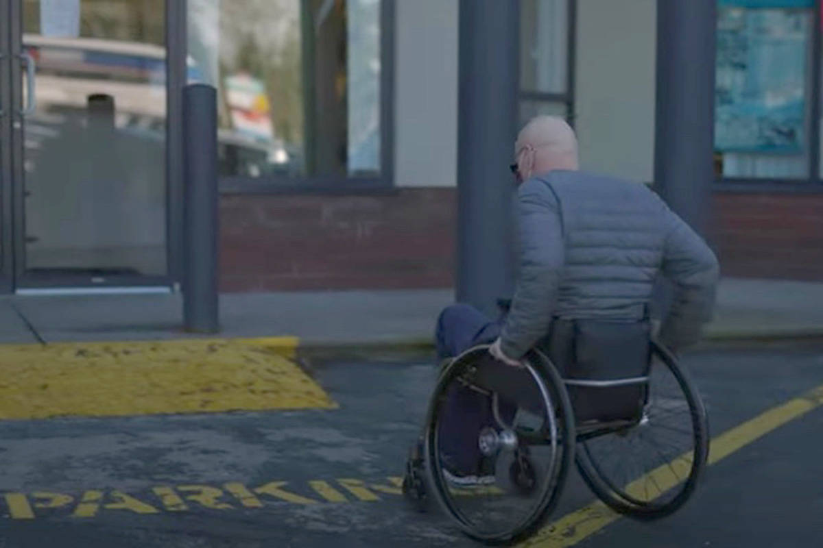 Langley Pos-Abilities is petitioning for better wheelchair access at the Brookswood Plaza shopping centre, where the sidewalks have multiple steps, and anyone using a wheelchair must traverse the parking lot. (Screencap/Langley Pos-Abilities video)