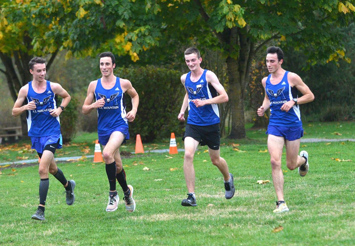 Jordan Schmidt (L) was part of the medal-winning R.E. Mountain Secondary senior boys cross-country team — along with Tate Wyatt, Felix Allen, Zach Wyatt. (Langley Advance Times file)