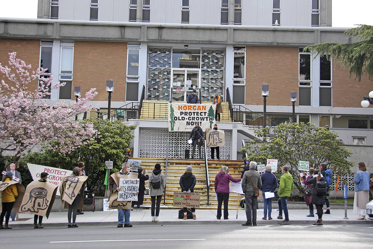 A couple dozen people gathered outside the Victoria courthouse April 1 to protest the logging of old-growth forests. At the same time, the B.C. Supreme Court ruled in favour of logging company Teal Jones, granting an application that will remove Fairy Creek blockades. (Jane Skrypnek/News Staff)