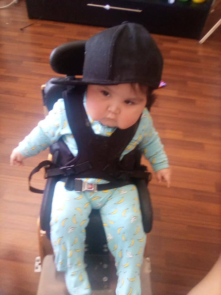 Wesley White was diagnosed with a brain injury following a difficult birth in Prince George. He is currently in a support sitting chair. (Submitted Photo/Kristy White)