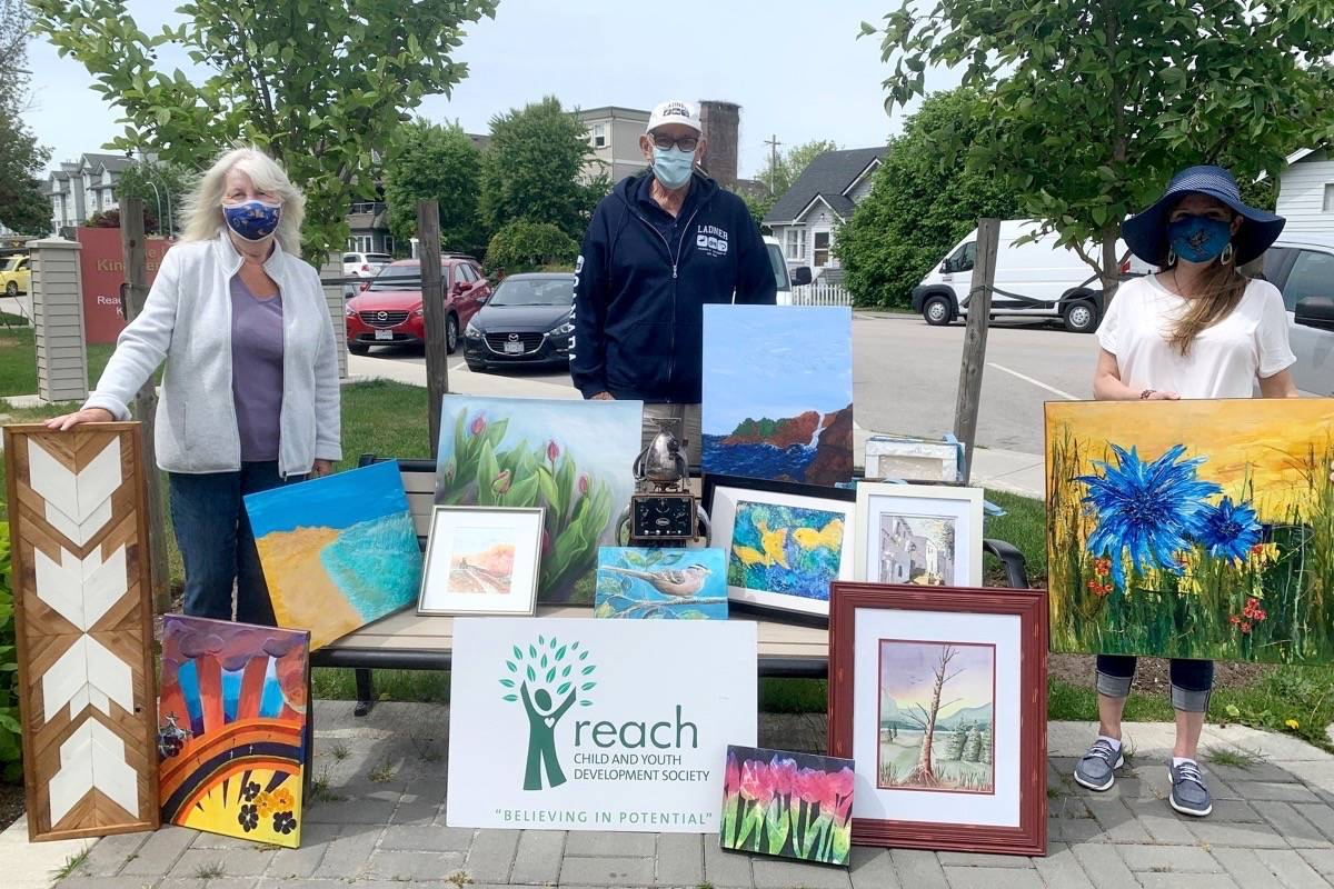 Rod Winning (centre) from the South Delta Artist's Guild delivers donations for Reach Child and Youth Development Society's second annual Reach for Beauty: Art Auction for Autism, to be held June 13-28, 2021. Also pictured are Reach Society volunteer Linda Edwards (left) and Reach development manager Kristin Bibbs (right). (Submitted photo)